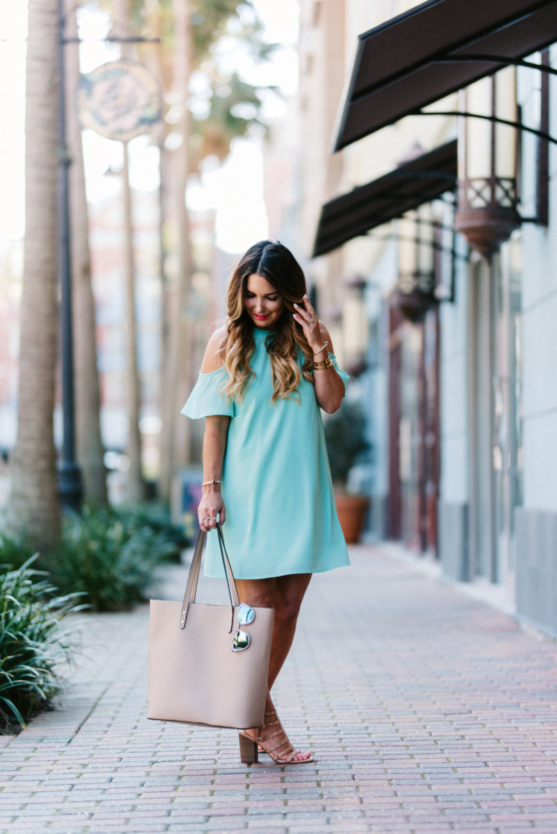 Spring vibes are in the air with this colder shoulder dress.